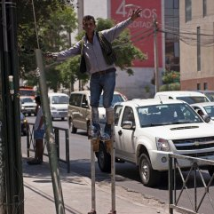 Traffic stilt-juggler